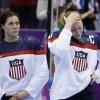 Photo - Meghan Duggan of the United States (10), right, reacts after Canada won 3-2 in overtime of the gold medal women's ice hockey game at the 2014 Winter Olympics, Wednesday, Feb. 19, 2014, in Sochi, Russia. (AP Photo/David Goldman)