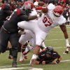 Oklahoma\'s Jamarkus McFarland (97) fumbles the ball after an interception beside Texas Tech\'s LaAdrian Waddle (65) during a college football game between the University of Oklahoma (OU) and Texas Tech University at Jones AT&T Stadium in Lubbock, Texas, Saturday, Oct. 6, 2012. Photo by Bryan Terry, The Oklahoman