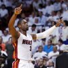 Photo -   Miami Heat guard Dwyane Wade rallies the crowd at the start of Game 1 in an NBA basketball Eastern Conference semifinal playoff series against the Indiana Pacers, Sunday, April 13, 2012, in Miami. (AP Photo/Wilfredo Lee)