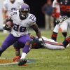 Photo - Minnesota Vikings running back Adrian Peterson (28) eludes a tackle by Chicago Bears cornerback Charles Tillman during the first half of an NFL football game on Sunday, Sept. 15, 2013, in Chicago. (AP Photo/Charles Rex Arbogast)