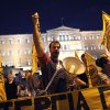 Protesters chant slogans in front of the Greek parliament during a union anti-austerity rally a day before the visit by German Chancellor Angela Merkel, in Athens on Monday, Oct. 8, 2012. Greek police have increased security and are preparing to close down large sections of the capital Athens to contain protests against Germany\'s Chancellor, Angela Merkel, who is visiting the city Tuesday for talks with the country\'s Prime Minister Antonis Samaras.(AP Photo/Petros Giannakouris)