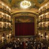 Photo - In this May 20, 2014 photo, people stand inside the Teatro Amazonas in Manaus, Brazil. The theater was a lavish vanity project of the rubber barons, whose plantations briefly catapulted Manaus into the ranks of the world's wealthiest cities in the late 19th century. (AP Photo/Felipe Dana)
