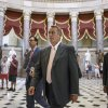 Photo - House Speaker John Boehner of Ohio strides to the House chamber  on Capitol Hill in Washington, Wednesday, July 30, 2014, as lawmakers prepare to move on legislation authorizing an election-year lawsuit against President Barack Obama that accuses him of exceeding his powers in enforcing his health care law. Democrats have branded the effort a political charade aimed at stirring up Republican voters for the fall congressional elections. They say it's also an effort by top Republicans to mollify conservatives who want Obama to be impeached — something Boehner said Tuesday he has no plans to do.  (AP Photo/J. Scott Applewhite)