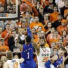 Kansas\' Naadir Tharpe (1) puts up a shot over Oklahoma State \'s Michael Cobbins (20) during the college basketball game between the Oklahoma State University Cowboys (OSU) and the University of Kanas Jayhawks (KU) at Gallagher-Iba Arena on Wednesday, Feb. 20, 2013, in Stillwater, Okla. Photo by Chris Landsberger, The Oklahoman