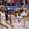 Photo - Stanford players, including Briana Roberson (10), wave to spectators following a first-round game against South Dakota in the NCAA women's college basketball tournament in Ames, Iowa, Saturday, March 22, 2014. Stanford won 81-62. (AP Photo/Nati Harnik)