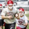 Ethan Biddy carries the ball as B.J. Morgan comes up from behind during a drill to strip the ball at Tuttle High School football practice in Tuttle, Okla. on Thursday, Aug. 13, 2009. Photo by Steve Sisney, The Oklahoman ORG XMIT: KOD