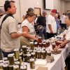 Visitors check out some of the items displayed at a table featuring products from A & K Enterprises at the Made in Oklahoma Festival held inside and on the grounds of the Reed Conference Center at the Sheraton Midwest City Hotel Saturday afternoon, May, 19, 2012. At right are owners, Pat and Aubrey Drew. Their business includes salsas, jams and jellies, pickled okra, peanut brittle and fudge. Photo by Jim Beckel, The Oklahoman