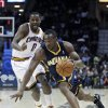 Indiana Pacers\' Sam Young, right, drives past Cleveland Cavaliers\' C.J. Miles (0) during the second quarter of an NBA basketball game on Friday, Dec. 21, 2012, in Cleveland. (AP Photo/Tony Dejak)