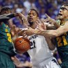 Kansas State forward Jordan Henriquez (21) tries to get a rebound between Baylor forward Cory Jefferson (34) and center Isaiah Austin (21) during the first half of an NCAA college basketball game in Manhattan, Kan., Saturday, Feb. 16, 2013. (AP Photo/Orlin Wagner)