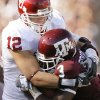 OU\'s Austin Box tackles Mike Goodson of Texas A&M during the college football game between the University of Oklahoma and Texas A&M University at Kyle Field in College Station, Texas, Saturday, November 8, 2008. BY BRYAN TERRY, THE OKLAHOMAN