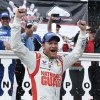 Photo - Dale Earnhardt Jr. celebrates in Victory Lane after winning the NASCAR Sprint Cup Series auto race at Pocono Raceway, Sunday, Aug. 3, 2014, in Long Pond, Pa. (AP Photo/Matt Slocum)
