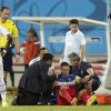 United States\' Clint Dempsey, centre on ground, is helped to his feet after he was injured during the group G World Cup soccer match between Ghana and the United States at the Arena das Dunas in Natal, Brazil, Monday, June 16, 2014. (AP Photo/Dolores Ochoa)