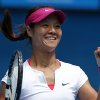 Photo - Li Na of China celebrates after defeating Flavia Pennetta of Italy during their quarterfinal at the Australian Open tennis championship in Melbourne, Australia, Tuesday, Jan. 21, 2014. (AP Photo/Aaron Favila)