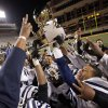 The Star Spencer Bobcats celebrate with the championship trophy after the Class 4A high school football state championship game between Star Spencer and Douglass at Boone Pickens Stadium in Stillwater, Okla., Saturday, December 5, 2009. Star Spencer won, 34-21. Photo by Nate Billings, The Oklahoman