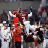 BEDLAM, FLIES, FLYING: Reggie Smith tries to fly for an interception during the second half of the college football game between the University of Oklahoma Sooners (OU) and the Oklahoma State University Cowboys (OSU) at the Gaylord Family -- Oklahoma Memorial Stadium on Saturday, Nov. 24, 2007, in Norman, Okla. Photo By STEVE SISNEY, The Oklahoman ORG XMIT: KOD