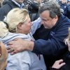 FILE - In this Nov. 2, 2012 file photo, New Jersey Gov. Chris Christie, right, meets Bonnie Miller after touring devastation from Superstorm Sandy in Brick, N.J. Christie can\'t get enough of