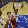 Houston Rockets\' Omer Asik, left, of Turkey, goes up for a shot against Philadelphia 76ers\' Thaddeus Young in the first half of an NBA basketball game, Saturday, Jan. 12, 2013, in Philadelphia. (AP Photo/Matt Slocum)