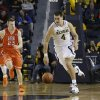 Michigan forward Mitch McGary (4) drives the ball up court during the first half of an NCAA college basketball game against Houston Baptist in Ann Arbor, Mich., Saturday, Dec. 7, 2013. (AP Photo/Carlos Osorio)