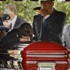 Michele Wright kisses the top of her son\'s, U.S. Army 1st Lt. David Timothy Wright II, casket as her husband Moore Police officer Tim Wright wipes the tears from his eye during graveside service at IOOF Cemetery on Tuesday, Sept. 21, 2009, in Norman, Okla. Wright was one of two soldiers killed Sept. 14th by an improvised explosive device in Afghanistan. Photo by Chris Landsberger, The Oklahoman
