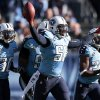 Photo - Tennessee Titans linebacker Akeem Ayers (56) celebrates after intercepting a pass against the Houston Texans in the third quarter of an NFL football game on Sunday, Dec. 29, 2013, in Nashville, Tenn. (AP Photo/Wade Payne)