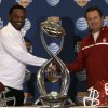 Texas A&M head coach Kevin Sumlin, left, and Oklahoma head coach Bob Stoops pose for photographers with the Cotton Bowl trophy after a news conference leading up to the NCAA college football game Wednesday, Jan. 2, 2013, in Irving, Texas. Before Sumlin became a successful head coach, he was on Stoops\' staff at Oklahoma. Before that, they were both assistant coaches recruiting the same area. Now Sumlin takes his Texas A&M team against Stoops\' Sooners in a Jan. 4th Cotton Bowl matchup of former Big 12 rivals that are both 10-2. (AP Photo/LM Otero) ORG XMIT: TXMO110