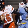 Norman\'s Zach Long rushes pas Putnam City\'s Lloyd Spaugy during the high school football game between Putnam City West and Norman at Putnam City High School, Thursday, Oct. 25, 2012. Photo by Sarah Phipps, The Oklahoman