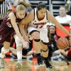 Louisville\'s Shoni Schimmel, right, runs down a loose ball ahead of Eastern Kentucky\'s Alexus Cooper during the second half of their NCAA college basketball game, Wednesday, Nov. 28, 2012, in Louisville, Ky. Louisville won 76-42. (AP Photo/Timothy D. Easley)