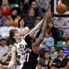 Photo - Utah Jazz's Gordon Hayward (20) and Portland Trail Blazers' J.J. Hickson (21) go after a rebound in the fourth quarter during an NBA basketball game Monday, April 1, 2013, in Salt Lake City. The Jazz defeated the Trail Blazers 112-102.  (AP Photo/Rick Bowmer)