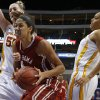 Oklahoma\'s Nicole Griffin (4) goes between Iowa State\'s Anna Prins (55) and Nikki Moody (4) during the Big 12 tournament women\'s college basketball game between the University of Oklahoma and Iowa State University at American Airlines Arena in Dallas, Sunday, March 10, 2012. Oklahoma lost 79-60. Photo by Bryan Terry, The Oklahoman