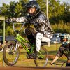 Photo - Right: Casey Sills tucks up as he rides over the first hill at Yukon BMX.  CHRIS LANDSBERGER
