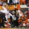 OU quarterback Sam Bradford is flipped in the air after a hitting OSU\'s Orie Lemon (41) during the second half of the college football game between the University of Oklahoma Sooners (OU) and Oklahoma State University Cowboys (OSU) at Boone Pickens Stadium on Saturday, Nov. 29, 2008, in Stillwater, Okla. STAFF PHOTO BY CHRIS LANDSBERGER