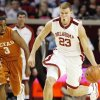 Photo - DRIBBLE: OU's Blake Griffin dribbles past UT's A.J. Abrams on a fast break in the first half during the Big 12 men's college basketball game between the University of Oklahoma and Texas at the Lloyd Noble Center in Norman, Okla., Monday, January 12, 2009. Photo By Nate Billings, The Oklahoman ORG XMIT: KOD