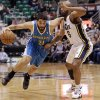 New Orleans Hornets\' Greivis Vasquez (21), of Venezuela, drives around Utah Jazz\'s Jamaal Tinsley (6)in the first quarter during an NBA basketball game Wednesday, Jan. 30, 2013, in Salt Lake City. (AP Photo/Rick Bowmer)