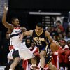 Photo -   Washington Wizards forward Trevor Ariza guards Indiana Pacers forward Gerald Green during the first half of an NBA basketball game Monday, Nov. 19, 2012, in Washington. (AP Photo/Alex Brandon)
