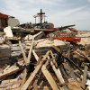 FILE - In this May 30, 2011, file photo damage is seen in a devastated Joplin, Mo. neighborhood. A federal agency was set to release a report Tuesday, Sept. 20, 2011, detailing communication efforts ahead of the massive twister that hit Joplin, killing more than 160 people. (AP Photo/Charlie Riedel, File) ORG XMIT: CER102