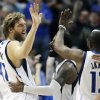 Dallas Mavericks forward Dirk Nowitzki (41), of Germany, celebrates with teammates O.J. Mayo, center, and Mike James (13) after scoring the game-winning basket during the second half of an NBA basketball game, Saturday, March 30, 2013, in Dallas. Dallas defeated Chicago 100-98. (AP Photo/Michael Mulvey)