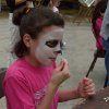 Abby Flax paints her face at May Fair in Norman on Sunday. Community Photo By: Jenna McIntosh Submitted By: Jenna,