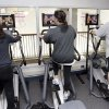 People workout at the Peninsula Jewish Community Center in Foster City, Calif., as they watch on television the presidential inauguration of President Barack Obama, Tuesday, Jan. 20, 2009. (AP Photo/Paul Sakuma)