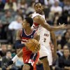 Photo - Toronto Raptors guard Alan Anderson, rear, defends against Washington Wizards guard Bradley Beal (3) during the first half of their NBA basketball game, Monday, Feb. 25, 2013, in Toronto. (AP Photo/The Canadian Press, Frank Gunn)