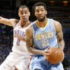 Oklahoma City\'s Thabo Sefolosha (2) defends Denver\'s Wilson Chandler (21) during the NBA basketball game between the Denver Nuggets and the Oklahoma City Thunder in the first round of the NBA playoffs at the Oklahoma City Arena, Sunday, April 17, 2011. Photo by Bryan Terry, The Oklahoman