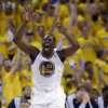 Golden State Warriors\' Draymond Green (23) celebrates after making a three-point basket against the Denver Nuggets during the second half of Game 6 in a first-round NBA basketball playoff series in Oakland, Calif., Thursday, May 2, 2013. Golden State won 92-88. (AP Photo/Marcio Jose Sanchez)