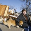 Trina Quinton sits with a lost dog at her cousin\'s destroyed furniture store, John\'s Furniture, on the north side of SH 70 in Lone Grove, Wednesday, Feb. 11, 2009. BY PAUL B. SOUTHERLAND, THE OKLAHOMAN
