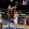 Oklahoma\'s Morgan Hook (10) goes to the bask beside Iowa State\'s Anna Prins (55) during the Big 12 tournament women\'s college basketball game between the University of Oklahoma and Iowa State University at American Airlines Arena in Dallas, Sunday, March 10, 2012. Oklahoma lost 79-60. Photo by Bryan Terry, The Oklahoman