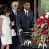 Donna Kelly Pratte, second from left, the mother of Kris Kross rapper Chris Kelly, follows the casket of her son during his funeral recessional along with her husband James Pratte, second right, Thursday, May 9, 2013, in Atlanta. The 34-year-old Kelly was found dead May 1 of a suspected drug overdose. Kriss Kross was introduced to the music world in 1992 by music producer and rapper Jermaine Dupri after he discovered the pair at a mall in southwest Atlanta. Kelly performed alongside Chris Smith, who known as