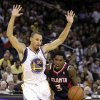 Atlanta Hawks\' Louis Williams, right, drives against Golden State Warriors\' Stephen Curry during the second half of an NBA basketball game on Wednesday, Nov. 14, 2012, in Oakland, Calif. (AP Photo/Ben Margot)