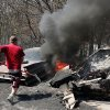 C. J. Clark runs after grabbing a rake to a 1961 Fleetwood Cadillac after the front seat burst into flames on the property of Lori Turner at 6000 NE 63 Wednesday; Clark had arrived at Turner\'s property to help her with clean up when her home and vehicles were burned yesterday when wildfires ravaged land and property that stretched from NE 50 on the south to Hefner Road on the north. The fire extended from Sooner Road to Midwest Blvd. Clark is a longtime friend of Turner\'s family. Photo taken Wednesday, Aug. 31, 2011. Photo by Jim Beckel, The Oklahoman
