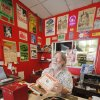 Store owner John Dunning holding up a 45 record at his Trolley Stop Record Shop in Oklahoma City Thursday, July 19, 2012. The record John\'s holding is titled