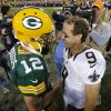 Photo -   Green Bay Packers quarterback Aaron Rodgers, left, and New Orleans Saints quarterback Drew Brees talk after an NFL football game Sunday, Sept. 30, 2012, in Green Bay, Wis. The Packers won 28-27. (AP Photo/Mike Roemer)