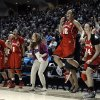 Photo - Nebraska players and coaches celebrate at the end of their second-round game against Texas A&M in the NCAA women's college basketball tournament in College Station, Texas, Monday, March 25, 2013. Nebraska won 74-63. (AP Photo/Pat Sullivan)