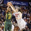 Photo - South Florida's Courtney Williams, left, shoots over Louisville's Jude Schimmel, right, during the first half of an NCAA college basketball game in the semifinals of the American Athletic Conference women's tournament, Sunday, March 9, 2014, in Uncasville, Conn. (AP Photo/Jessica Hill)